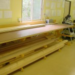 Dalmau E Bench used to store lengths of timber